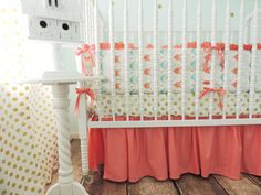 Gorgeous crib bedding from @tushiestantrums - You had at us gold polka dot crib sheets, but the arrow-inspired bumpers are too sweet for words! #nursery