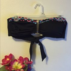 a.n.a. Bikini swimsuit top. A unique bikini top with tie straps.  Can be worn worth any black bottoms!  Comes with halter strap for extra hold.  Is lightly padded and is only worn twice.  Size 10 but fits like a medium or large. a.n.a Swim Bikinis