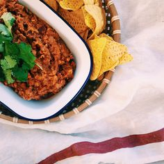 The freakin best thing to do with old cans of lentils, beans and tomatoes in your pantry. Over toast with poached eggs, in a quesadilla or just as a dip!