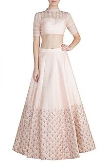 Featuring a peach pink crop top in silk and net base with diamond, rose gold and green embroidery. It is paired with matching skirt. FIT: Fitted at bust and waist. CARE: Dry clean only. Indian Fashion Designers, Indian Designer Wear, Indian Crop Tops, Crop Top Designs, Pink Peacock, Or Rose, Rose Gold, Pink Crop Top, Pernia Pop Up Shop