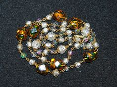 Check out this item in my Etsy shop https://www.etsy.com/listing/251128351/art-deco-venetian-glass-bead-necklace-bi