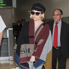 Sienna Miller Ups Her Casual Jet-Setting Style with the Burberry Blanket Poncho  #InStyle