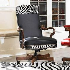 ZEBRA YOKE OFFICE CHAIR  _  A striking chair to increase your creativity! Classic black leather seat has a swivel pedestal that allows for 360° turning. Our zebra leather is stenciled on cowhide by skilled artisans using customized inks and templates in shades of black and white.