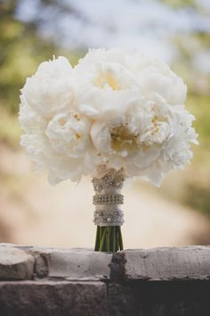 White peonies with the rhinestones around the stem look glamorous. MC