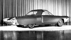 """In 1962, Chrysler put together the Typhoon, a """"mock-up"""" of what a turbine powered car would look like. Elwood P. Engle was the new director of design and from what I have been told the actual artist who penned the disign of the Typhoon was Mr. Charles Mashigan. Mr. Engle had only been with Chrysler since November of 1961 and maybe it was his input that made them look so much like the early 60's T-Birds or did Mr. Mashigan imagine the style."""
