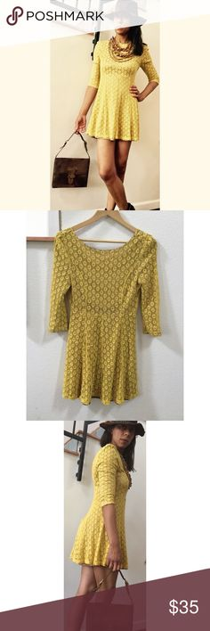 """Mustard Yellow Crochet Vintage Dress This adorable dress is crochet. With a satin brown slip that is super comfortable to wear. Long sleeves. Scoop backing with zipper. Tag says size L. Measures- shoulder-shoulder-16"""". Sleeves17"""". Bust-30"""". Waist-28. Length- 30"""". Vintage Magic Dresses Mini"""