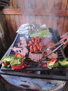 Birthday barbecue feast for our mountain bike guide in Oaxaca. Peppers stuffed with Oaxacan cheese, steak, chorizo, spring onions, and salsa, tortillas, and guacamole - all washed down with cerveza!