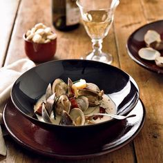 Viognier-Steamed Clams with Bacon and Parsnips | Chef Dean Maupin thinks most things taste better with smoky bacon. These bacon-garnished briny clams, steamed in Virginia's fruity and floral Viognier, are such a big hit that he serves them regularly during the cooler spring and fall months.