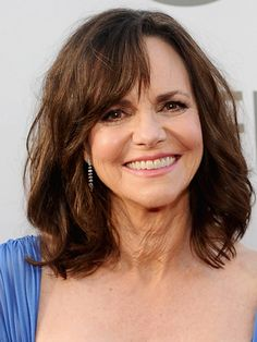 "Lob With Side-Swept Bangs. Sally Field  ""What makes this so flattering is that her bangs are really choppy and messy,"" says Fugate. Field's bangs start short at the middle of her forehead and cascade down, pulling away from her face as they get longer to show off her cheekbones."