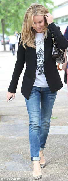 Smart casual: Amanda wore a pair of blue jeans with a black blazer and heels...