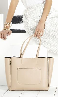 Large tote bag in nude with shape-changing side zippers and shoulder straps