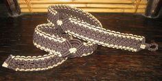this guitar strap is made from 6 strands of cord in a 12 strand knotting pattern. there are three button holes provided for adjustment. its over-all length is 44 inches. there are no splices in this piece.