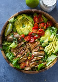 An easy and delicious salad made with grilled chicken, avocados, tomatoes, and a greek yogurt based creamy skinny salad dressing.  Have I ever mentioned how much I love salads? If it weren't …