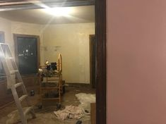 Here is the dining room for the wallpaper, which must be complementary to the mauve wall.