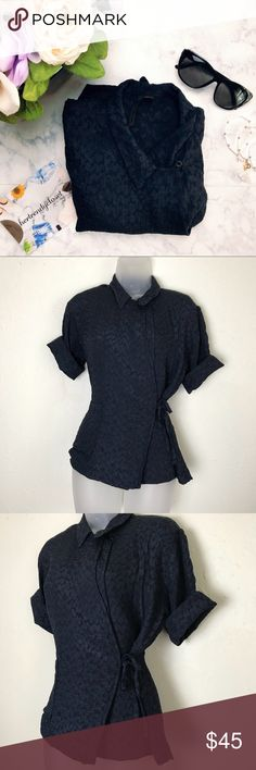 TOPSHOP Boutique   Navy Blue Blouse TOPSHOP boutique blouse. Gorgeous top that ties together as pictured! Has a textural fabric that is so fun with a fun blend it pattern. Great for multiple occasions! Also, doesn't have a size or tag on it but looks like it'll fit between a medium and large. Check measurements to be sure! Also, it is adjustable with the tie. 💕B4-198 Measurements: L-23in. W-18in. Topshop Tops Blouses