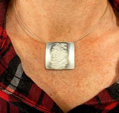 Penny made this sterling silver pendant with concealed bail in the Intensive Beginners Jewellery Short Course. She used one of the pattern stamps to create this lovely texture.