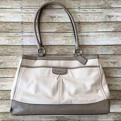 """Coach Park Leather Handbag Coach Park Putty/Stone Leather Carryall Shoulder Handbag No.K1220-F19728. Front outside pocket. Silver hardware with Coach drop tag. Pink fabric lining with one zippered pocket & two multifunction pockets. Zip-top closure with leather straps. Sides have snap closures. Good condition with minor wear. No rips, tears, or staining on inside fabric.   14.5""""(L)x9.75""""(H)x5.25""""(W). Strap drop 9.25"""" drop Coach Bags"""
