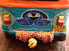A close up of the back of the tuk tuk at the Asian bride Live wedding exhibition.  It reminded me of Fuschia's new Asian collection launching for 2014 called Pride of The Peacock. These stunning Asian tuk tuks can be hired from www.tukshop.biz.