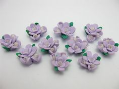 fimo flower 4 by ThirdEarDear on Etsy, $1.60..use to put on large fillagrie leaf background earring