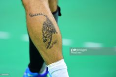 A tattoo depicting a cheetah is seen on the leg of Croatia's right back Zlatko Horvat during the men's preliminaries Group A handball match Croatia vs Qatar for the Rio 2016 Olympics Games at the Future Arena in Rio on August 7, 2016. / AFP / afp / FRANCK