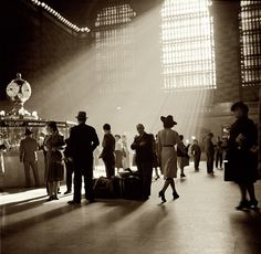 October 1941. The main-concourse information desk at Grand Central Terminal in New York. Medium format nitrate negative by John Collier.