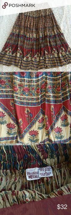 Vintage Bohemian Cotton Floral Maxi Skirt L Gorgeous floral print  Super lightweight gauzy cotton  Earthy fall colors Elastic waist Made in India, says size large but might fit a medium better since elastic is fairly taut. Most of skirt is in great condition although I did discover a small little tear near the waist band. The folds of the skirt hide it well and a few stitches would repair it. Skirts Maxi