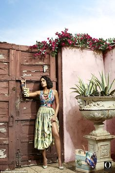 Mixing prints: Rosario lifted her patterned skirt as she held on to a rustic door frame for this sultry outdoor shot.