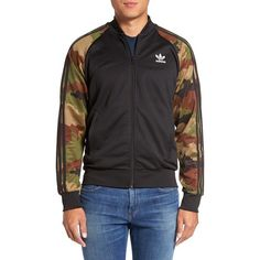 Men's Adidas Originals 'Essential' Camo-Sleeve Track Jacket ($75) ❤ liked on Polyvore featuring men's fashion, men's clothing, men's activewear, men's activewear jackets, black, mens track tops, mens track jackets and mens activewear