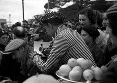 Josephine Baker giving a fan her autograph.