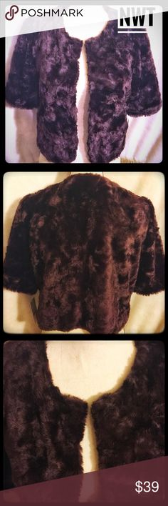 ✨NWT Faux Mink Fur Jacket Shrug✨ Absolutely GORGEOUS Faux Mink Fur jacket/shrug. The color is a rich warm brown and the fur is a soft textureddesign. The front enclosures are 4 hook and loops. It is a stunning piece, NWT, never worn and absolutely gorgeous! Enjoy my Posher shoppers! Katherine Kelly Jackets & Coats