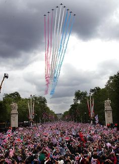 Colourful display ... Red Arrows match the sea of red, white and blue outside Buckingham Palace. Peter Jordan/ NI Syndication