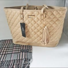 "BCBG Paris Quilted Tan Tote NWT tote. Soft quilted tan leather, gold hardware and cute tassel make this bag the best accessory to any outfit! Perfect condition. Dimensions: 20x12x5.5"" BCBG Bags Totes"