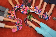Go to craft store and pick up bandannas.  Cut the bandannas 11/2 inch wide, 9inch long.  The colorful the bandanna the better. Tie the cut bandanna around the flip flop in 2 knots.  From one end to another.  Lots of fun for girls that can tie there own knots.