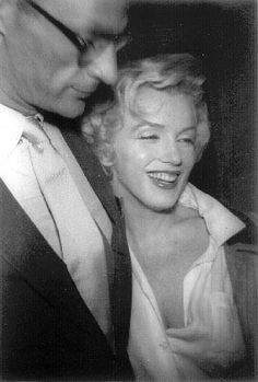 Marilyn and Arthur Miller leaving their Sutton Place, NYC apartment to join Milller's parents in Brooklyn for dinner, June 1956.