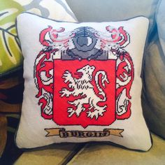 Custom Family Crest Needlepoint Pillow - I kind of want to make one for both of my parents' family names to have with me someday as a reminder of my family.