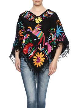 Mexican completely handmade fringe on soft cotton fabric and hand embroidered with the colorful designs of otomi embroidery. Poncho features a round neckline, pointed hem and fringe trimming. Mexican Embroidered Dress, Mexican Embroidery, Mexican Blouse, Mexican Outfit, Mexican Dresses, Mexican Style, Embroidered Blouse, Mexican Clothing, Poncho Mexican