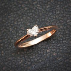 This is a natural diamond flower engagement ring from Camellia Jewelry. This unique design ring features a solid two tone gold band with leaf accents and a luminous natural diamond in the center to complete the design. It is an inspired by nature ring Gold Band Ring, Diamond Solitaire Rings, Ring Verlobung, Diamond Jewelry, Jewelry Rings, Jewellery Stand, Jewelry Ideas, Jewellery Shops, Silver Jewelry
