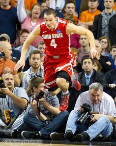 Ohio State guard Aaron Craft hurdles photographers after making a stellar defensive play during Ohio State's win against Syracuse.