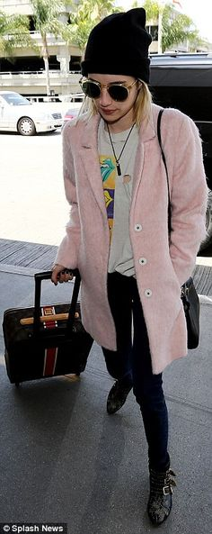 Safe travels! The pretty blonde Emma Roberts strode through the airport to board her flight