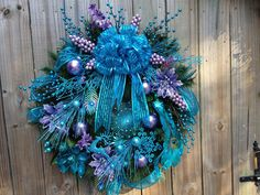 Teal and Lavender Peacock Christmas Wreath. $195.00, via Etsy.