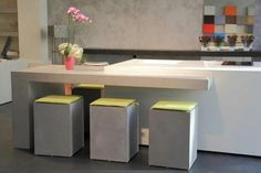 Italy's Microfloor showroom.  Stools, floor, furniture, frames in the wall and the walls.