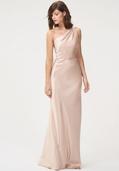 5a596d51960 The Lena dress features a trendy one shoulder neckline with wrapped  pleating on the strap for
