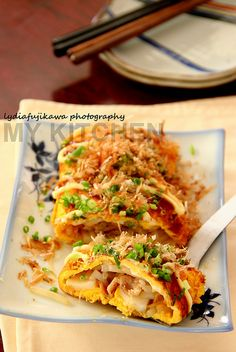 Tonpeyaki (豚平焼き) is stuffed rolled omelet with pork and bean sprouts, simplest explanation. There are options for extra stuffing such as mochi and cheese. It is usually served hot on teppan (hot plate) so that it remained hot, soft mochi or melted cheese, to the last bite.