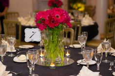 Simple hot pink gerber daisy centerpieces with black linens | Ana & Ophelia's modern, hot pink & black Maryland wedding at Ceresville Mansion | Images: Eastport Photography