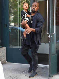 Kanye carrying baby Nori