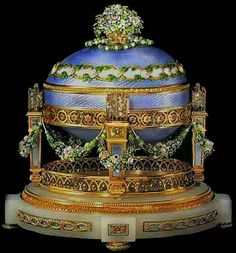 """#Fabergé -- """"Love Trophies Egg"""" -- aka -- """"Cradle With Garlands Egg"""" -- 1907 -- A gift from Nicholas II to the Dowager Empress, Maria Fyodorovna (proven via an invoice discovered in 1979) -- Workmaster: Henrik Wigstrom -- Varicolored gold, enamel, opalescent oyster enamel, diamonds, rubies, pearls, white onyx & silk lining. According to the original invoice, the surprise (now missing) was a miniature portrait of all the imperial children. Private Collection as of 1989."""