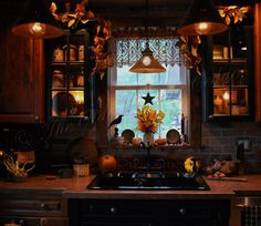 I adore the black next to the wood along with the brick back splash ~