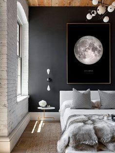 Full Moon Poster La Luna Printable Full Moon Print by printabold with a white brick wall, lots of textures, scandi bedroom, modern side table, accent pillows and a dark blue wall.