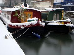 Snow and narrow boats in Regent Canal, London, UK. Photo ©Aybige Mert