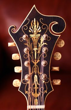 "Not a guitar as sometimes pinned: 8 string Vintage Gibson MANDOLIN - yellowed ivory keys w floral designs. Inlays on headstock, w lovely curved scrimshaw like lines of cut. RESEARCH by DdO:) - http://www.pinterest.com/DianaDeeOsborne/instruments-for-joy/ - INSTRUMENTS FOR JOY, says this is an F5 mandolin with the F shape made popular in the 1920s thanks to Gibson. Some instruments engraved with word ""THE"" in front of company name. Enlarge to see beauty insets sparkle. Pinned via Alan Gorney"